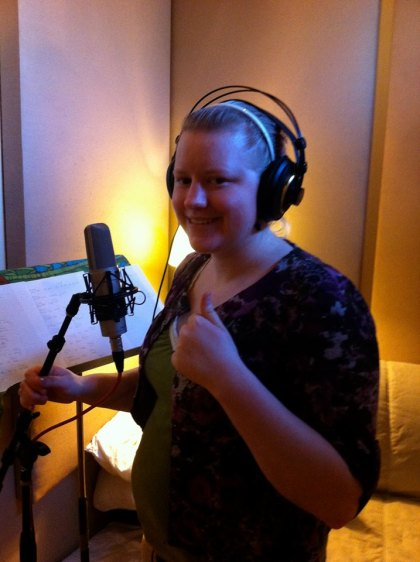 "Recording the vocal tracks to my song ""Words Can't Express."""